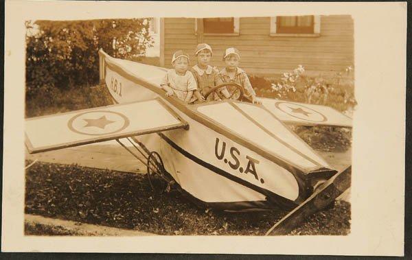1507: A REAL PHOTO POSTCARD pedal plane children