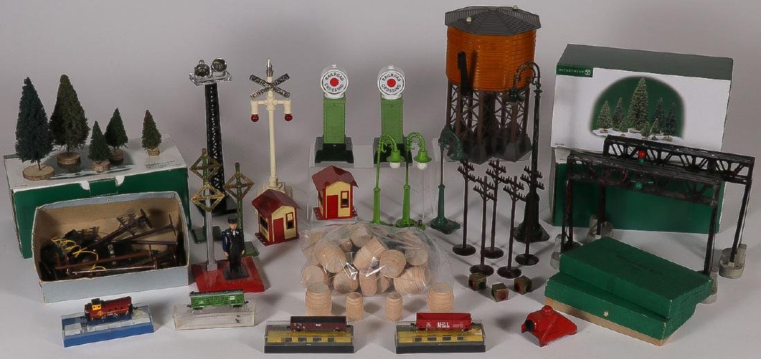 A GROUP OF MODEL TRAIN SWITCHES AND ACCESSORIES