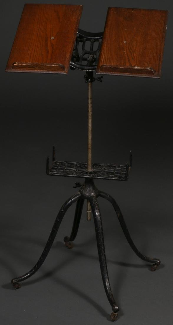 ANTIQUE CAST IRON AND OAK BOOK STAND.