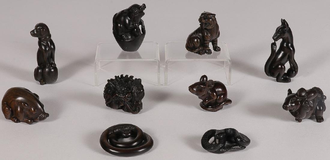EIGHT CARVED WOOD NETSUKES, 20TH CENTURY