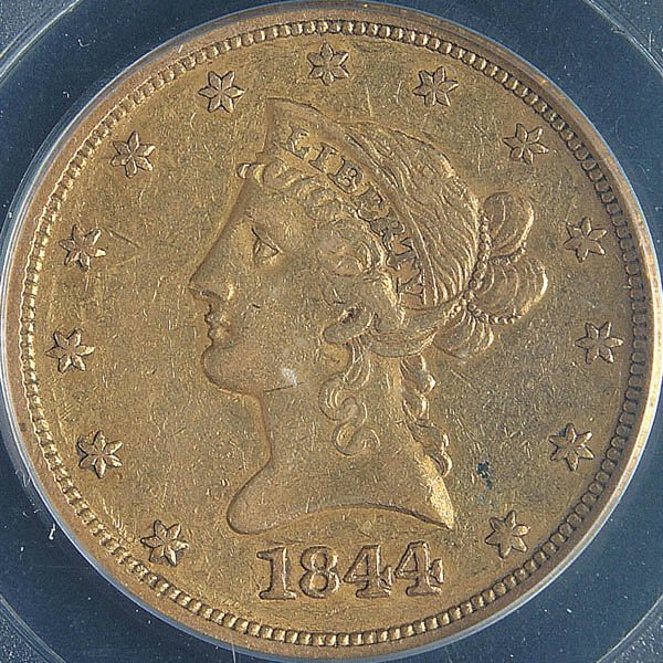 7: A U.S. GOLD EAGLE 1844-O, graded PCGS XF-40. Esti