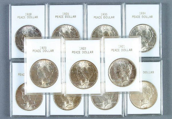 57: A GROUP OF 13 U.S. PEACE DOLLARS, cased not grade