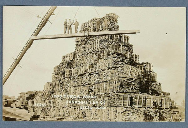 605: A REAL PHOTO ADVERTISING POSTCARD for a Lumber co