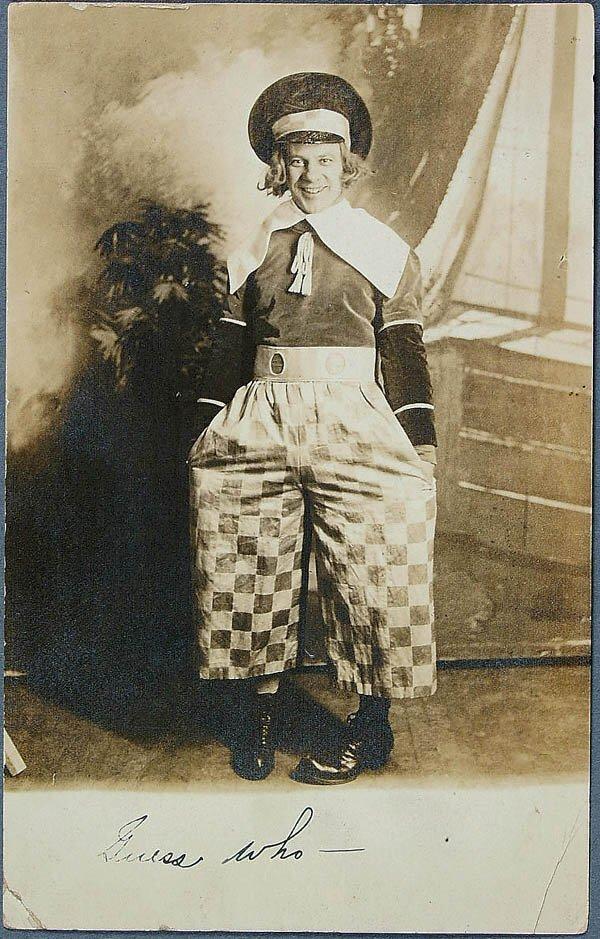 610: A BUSTER BROWN REAL PHOTO POSTCARD depicting a yo