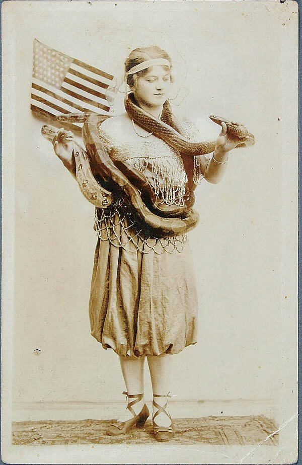 611: A REAL PHOTO SNAKE ODDITY POSTCARD of a woman wit