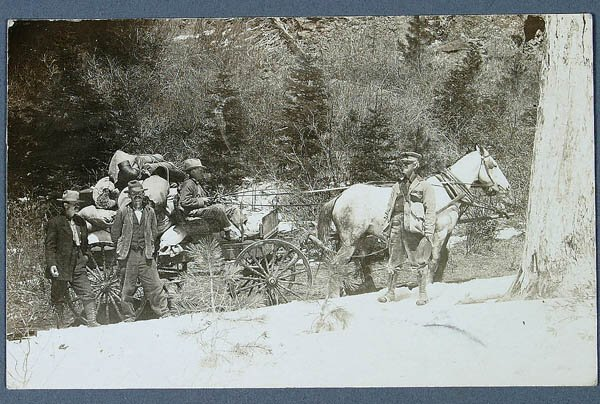 619: A REAL PHOTO MINING POSTCARD of miners and wagon