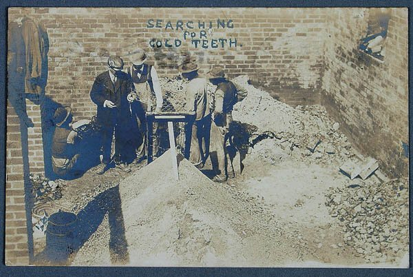 """622: A REAL PHOTO POSTCARD of a group of men """"searchin"""