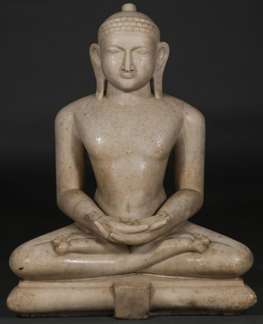 A LARGE AND IMPOSING CARVED MARBLE BUDDHA