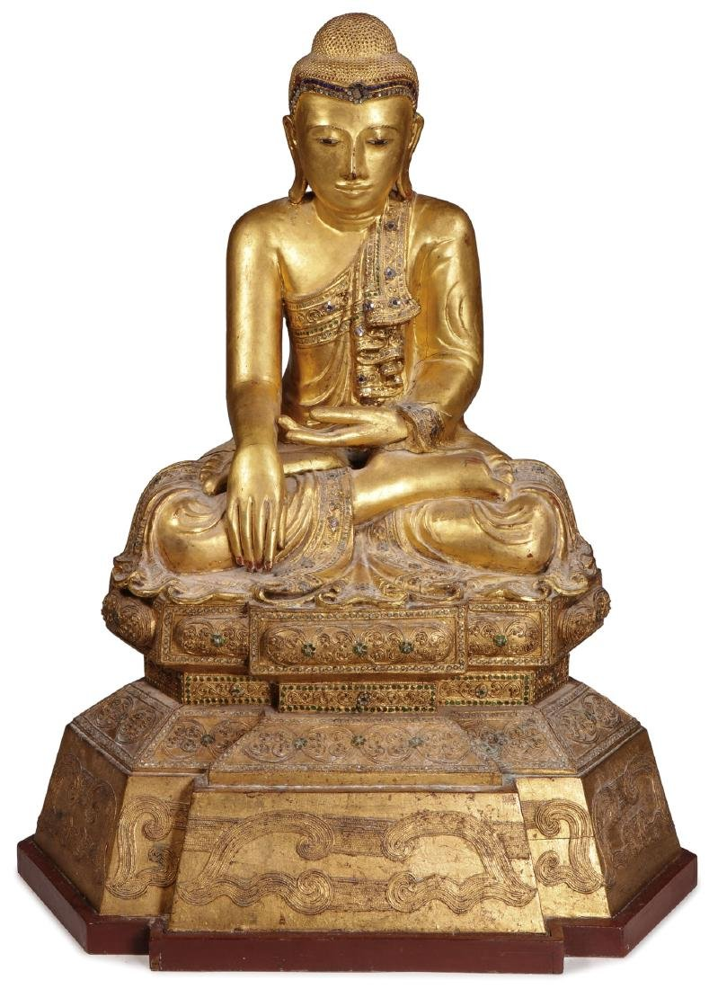 A LARGE AND IMPOSING CARVED GILT WOOD BUDDHA