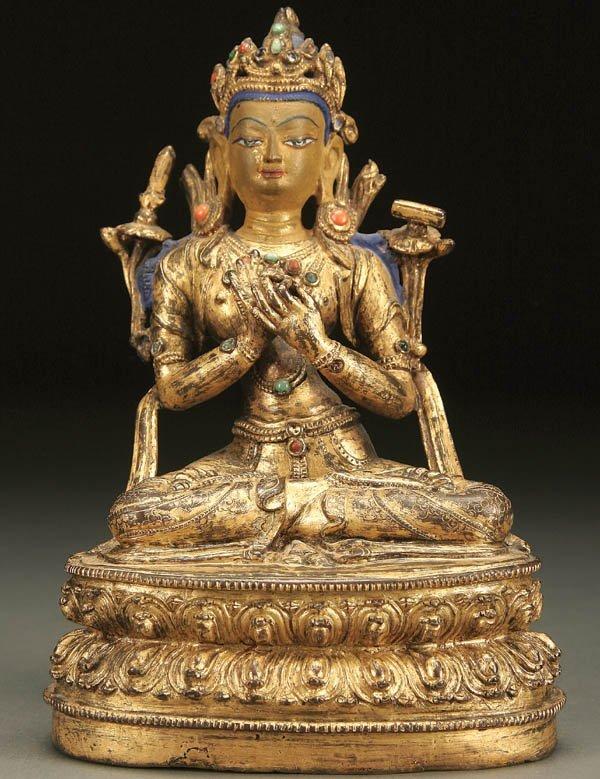 761: A CHINESE GILT-COPPER FIGURE OF MANJUSHRI, NEPAL