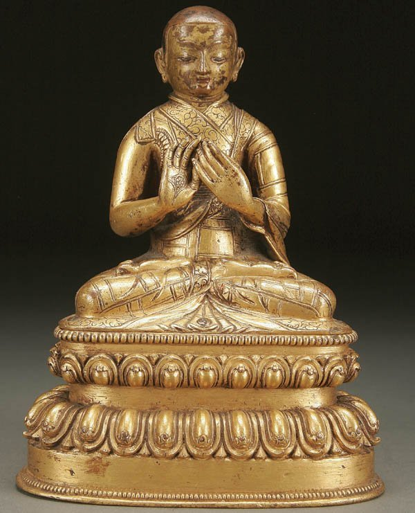 762: A CHINESE GILT-COPPER TEACHING MONK, TIBET,