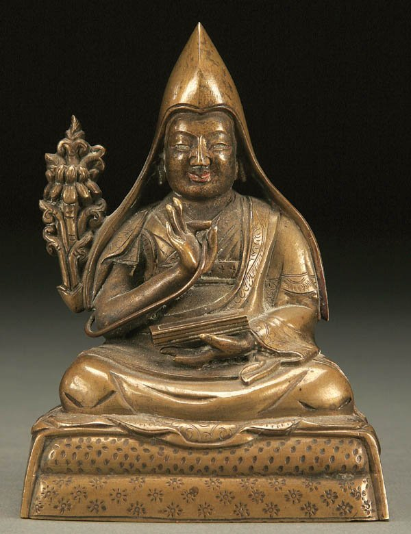 766: A CHINESE BRONZE SEATED FIGURE OF A MONK NEPAL