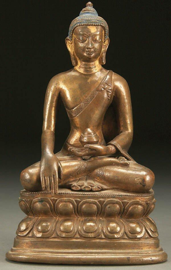 773: A CHINESE SEATED FIGURE OF SHAKYAMUNI BUDDHA