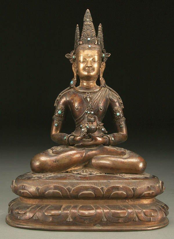 774: A CHINESE GILT COPPER   FIGURE  Shakyamuni Buddha
