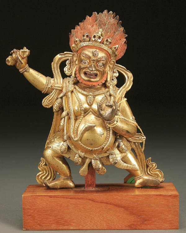 775: A CHINESE GILT COPPER STANDING FIGURE