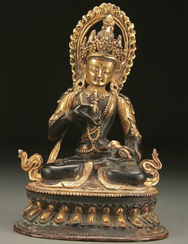 776: A CHINESE GILT BRONZE SEATED FIGURE of Black Tara