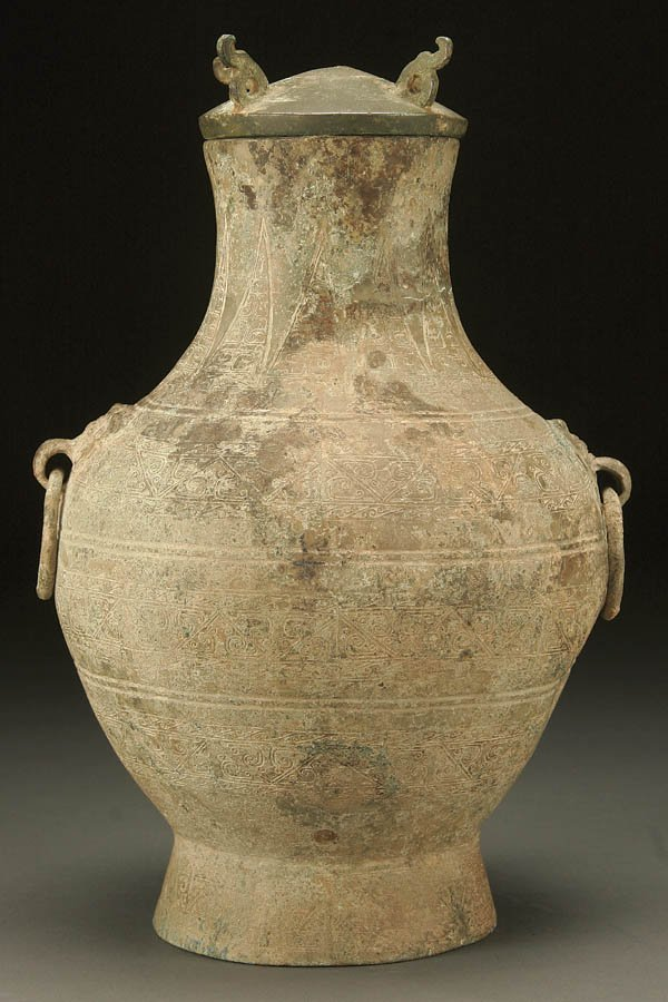 784:  A CHINESE HU FORM BRONZE COVERED VESSEL  HAN