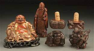 1203: A JAPANESE CARVED WOODEN FIGURE GROUP early to mi