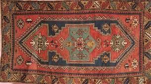 1293: A KAZAK HAND WOVEN ORIENTAL RUG circa 1930, with