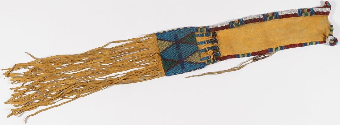 AN ATTRACTIVE BEADED PIPE BAG