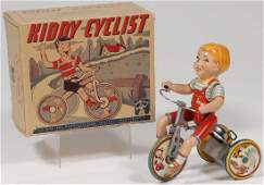 A UNIQUE ART KIDDY CYCLIST WITH BOX