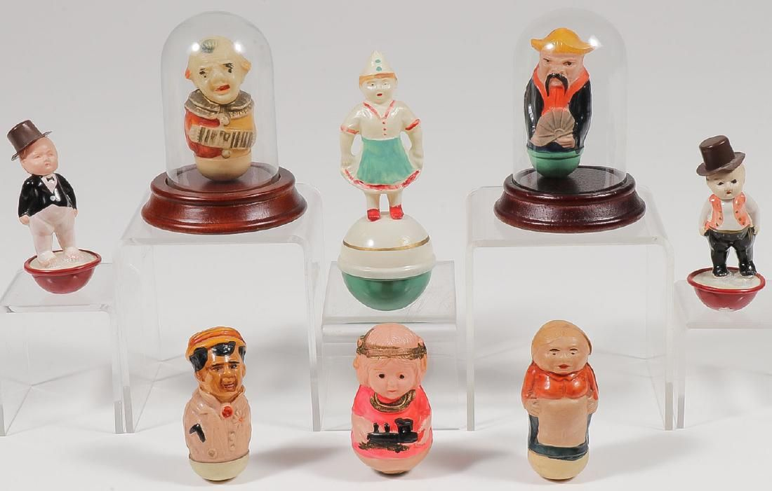 EIGHT MINI CELLULOID ROLY-POLY'S