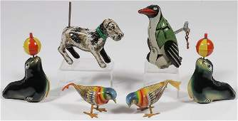 SIX TIN WIND-UPS AND FRICTION TOYS
