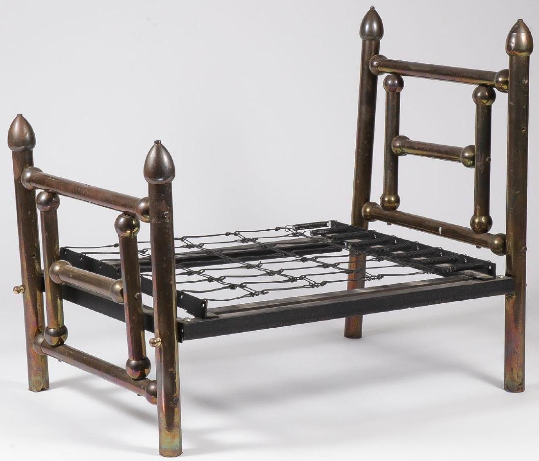 A VINTAGE DOLL BRASS BED
