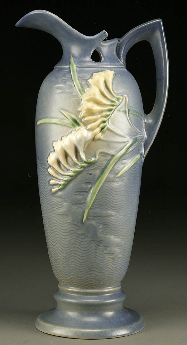 7: A ROSEVILLE FREESIA POTTERY LARGE HANDLED EWER; m