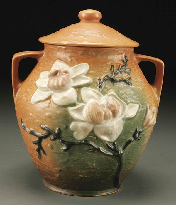 9: A ROSEVILLE MAGNOLIA POTTERY COOKIE JAR; in caram