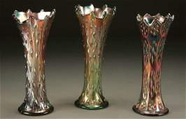 963: A 3-PIECE GROUPING OF CARNIVAL GLASS SWUNG VASES;