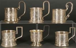SIX RUSSIAN SILVER TEA GLASS HOLDERS CIRCA 1900