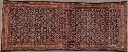 A LARGE PERSIAN HAMADAN CARPET CIRCA 1930S