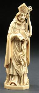 217: A FINELY CARVED IVORY FIGURE: A Bishop Saint, Fre