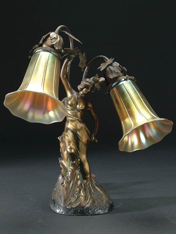 667: AN ART NOUVEAU STYLE METAL FIGURAL LAMP circa 190