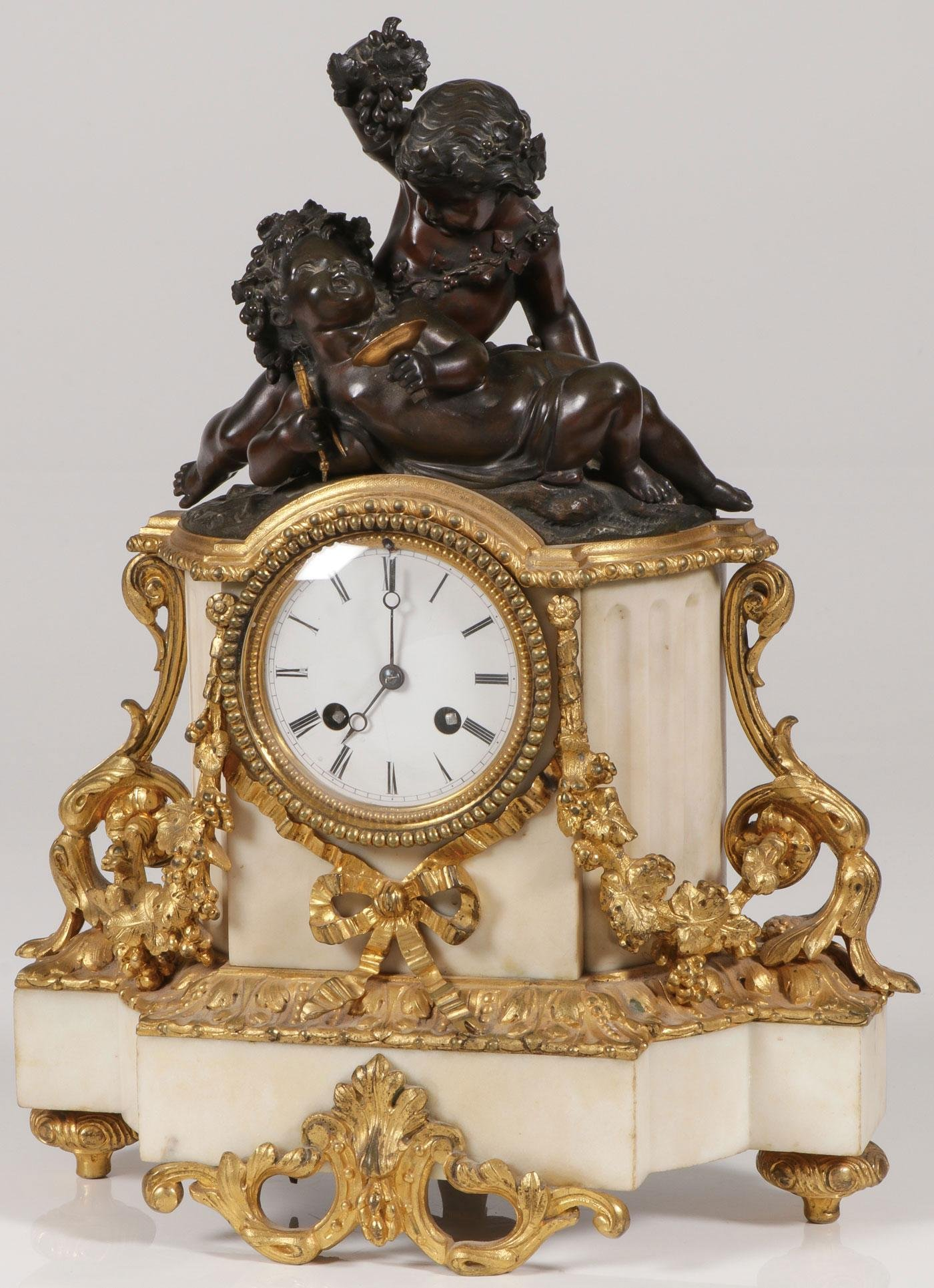 A FRENCH ORMOLU MARBLE & BRONZE MANTLE CLOCK
