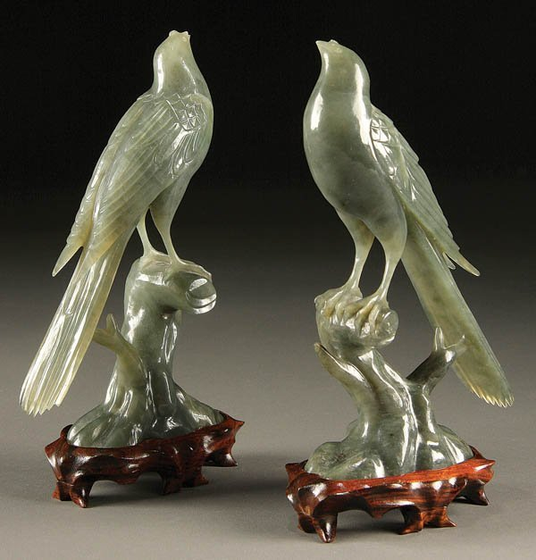 1202: A PAIR OF CARVED JADEITE FIGURES, mid 20th centur