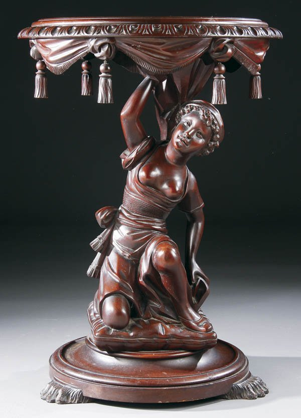 690: A VICTORIAN FIGURAL CARVED MAHOGANY PARLOR TABLE