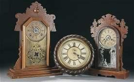 "1050: PAIR VICTORIAN WALNUT ""GINGERBREAD"" SHELF CLOCKS"