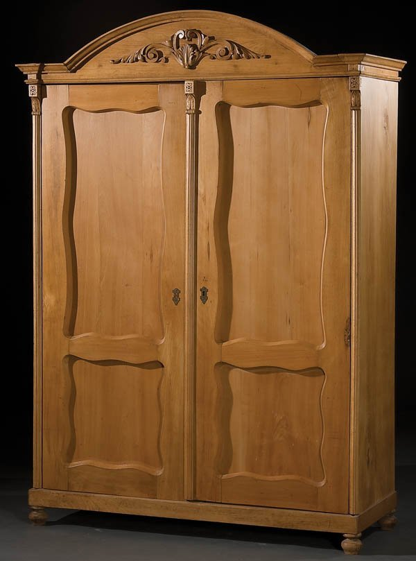 17: AUSTRIAN CARVED PROVINCIAL PINE ARMOIRE
