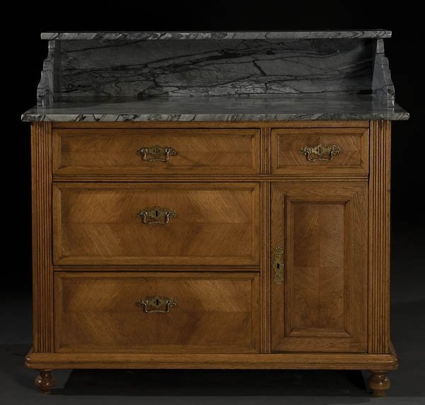 23: AUSTRIAN PANELED WALNUT AND MARBLE TOPPED COMMODE
