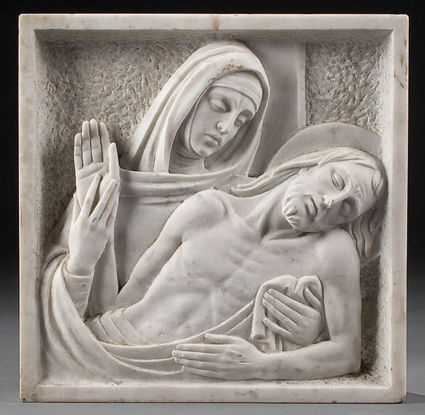 763C: A CARVED RELIEF MARBLE PLAQUE depicting the Pieta