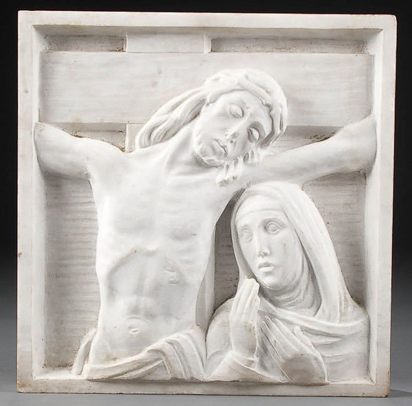 765: A CARVED RELIEF MARBLE PLAQUE depicting the Cruci