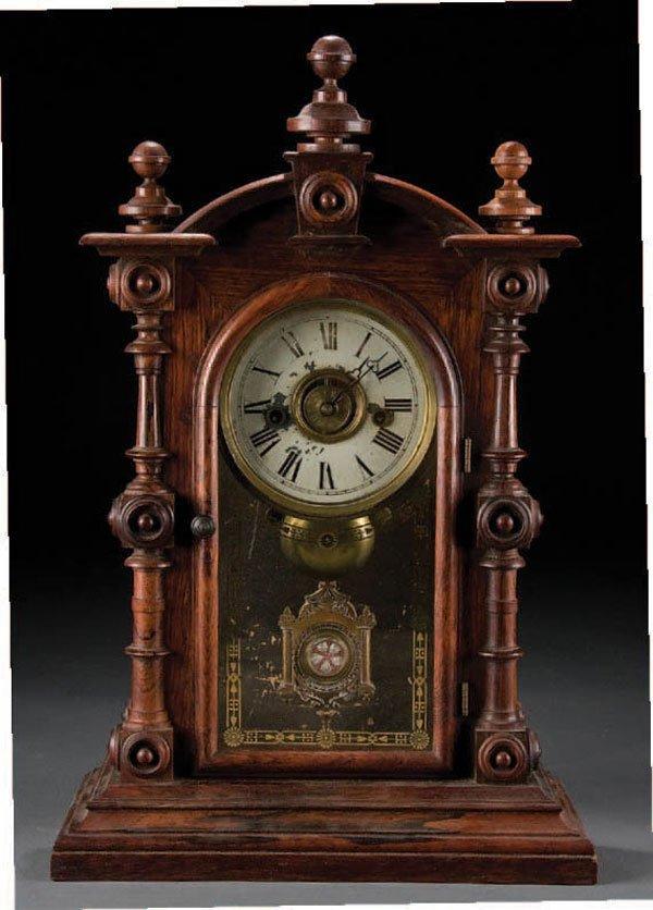 979: A FINE WALNUT EIGHT DAY SHELF CLOCK with turned d