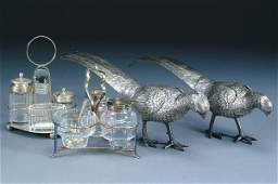 A PAIR OF SILVER PLATE FIGURAL PHEASANTS length 1