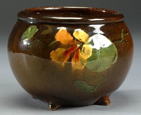 650: A MCCOY FOOTED BOWL, circa 1910, dark brown glaze