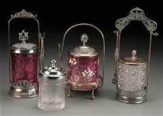 197 FOUR VICTORIAN GLASS AND SILVER PLATE PICKLE CAST