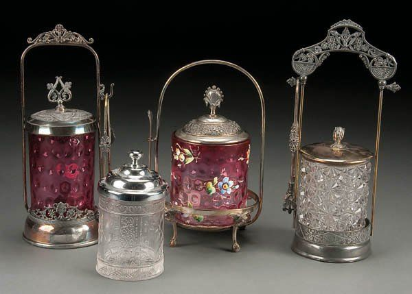 197: FOUR VICTORIAN GLASS AND SILVER PLATE PICKLE CAST