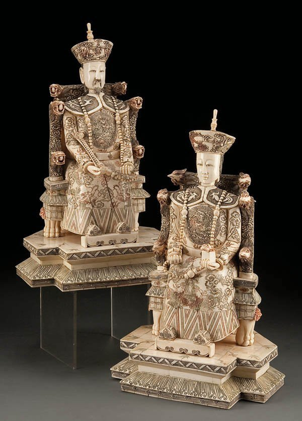 431: A PAIR OF CARVED BONE AND IVORY EMPEROR AND