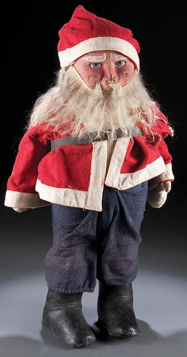 655: A VINTAGE TOY SANTA CLAUS circa 1930's, with pain